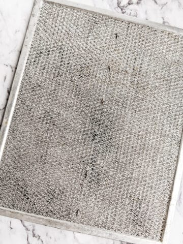 cleaning stove fan filter