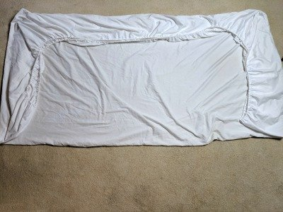 tip to fold a fitted sheet