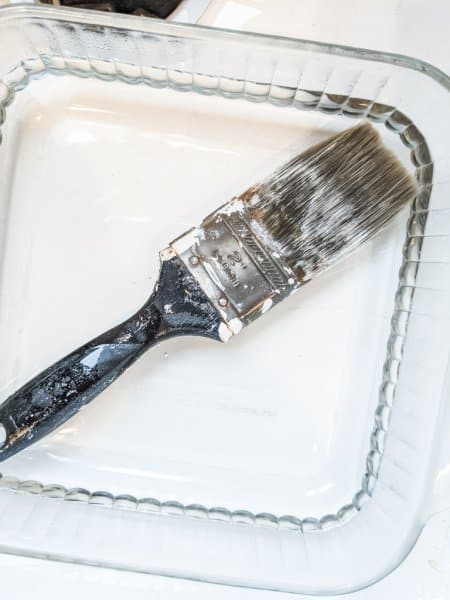 soaking brushes in vinegar to remove hardened paint